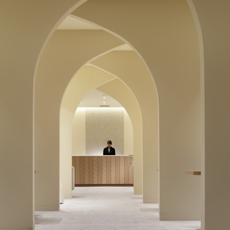 Curving walls create arched avenue through wedding planning venue by Ryo Matsui Architects