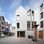 Franken Architekten engraves ghost timbers into facade of Frankfurt house