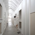 Ladders lead to capsule-sized bedrooms in Koyasan Guesthouse by Alphaville