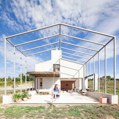 Anna and Eugeni Bach extend gabled stone house with skeletal framework