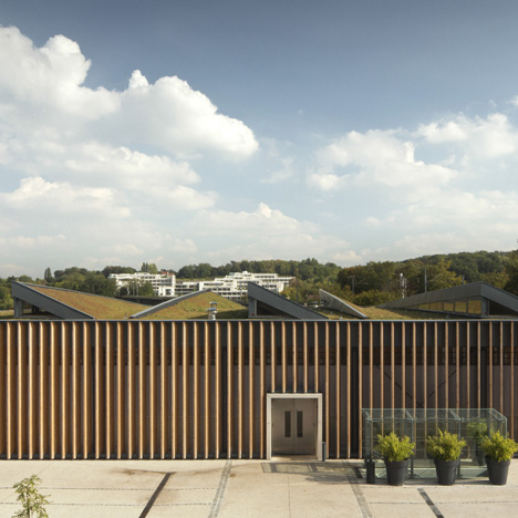 Wooden louvres and grassy rooftops added to Marly-le-Roi market hall