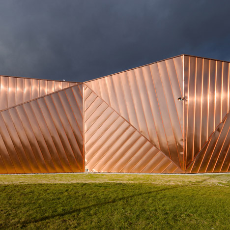 Copper panels give a flame-like appearance to Museum of Fire in Poland
