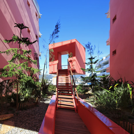 Cerise walls frame rooftop garden of housing block by Pietri Architectes