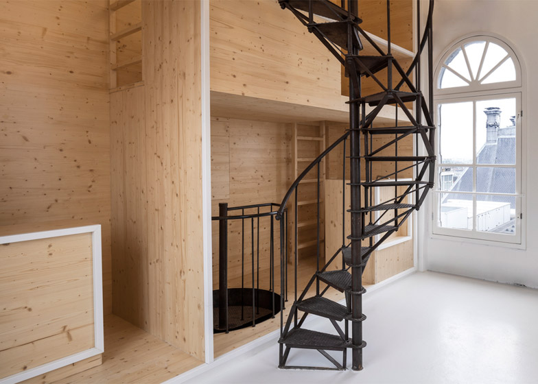 i29's wooden wall turns historic department store tower into artists' residence