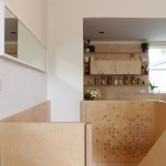 Carl Trenfield adds perforated timber around the rooms and stairs of a London home