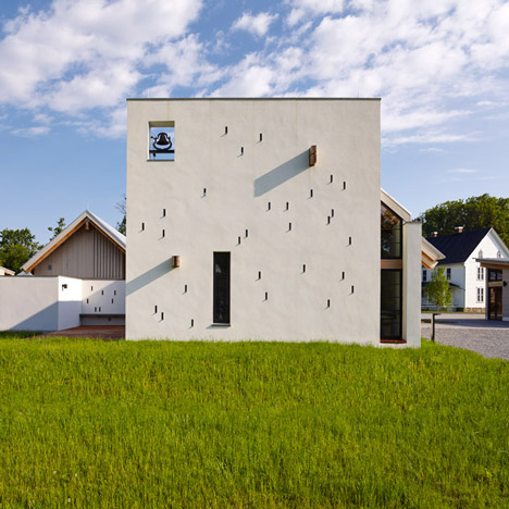 University chapel by Dynerman Architects hides its true form behind a square wall
