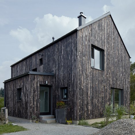 Mjölk Architekti's Carbon house features a burnt wood exterior