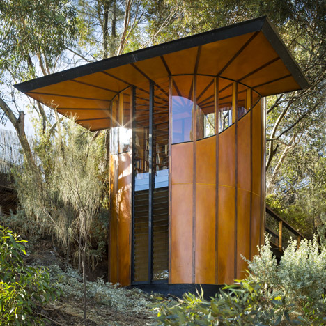 A tube of striped orange wood encloses Max Pritchard's treetop studio
