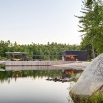Blackened-timber boathouse completed by Weiss Architecture on a Canadian island
