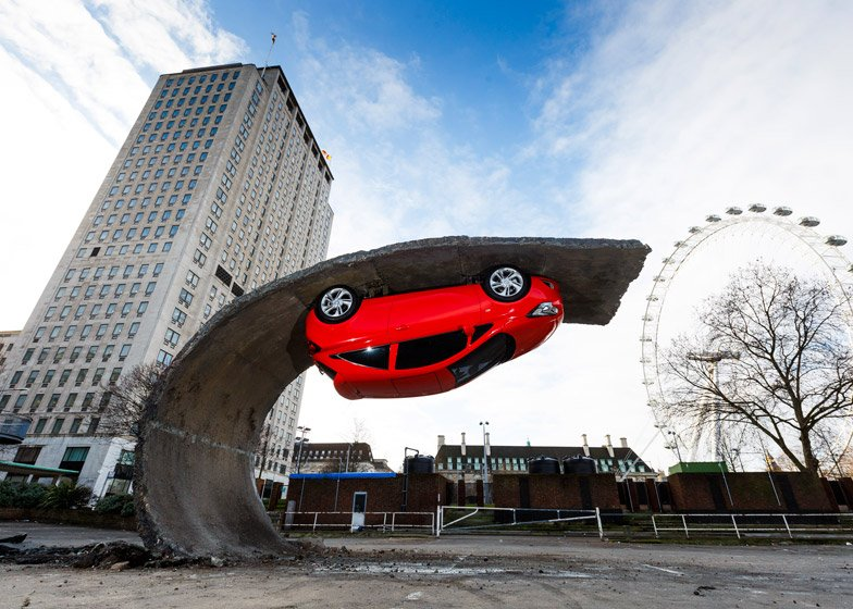 Car upended on tarmac wave in alex chinneck installation 7 of 7 alex chinneck for vauxhall motors pick yourself up and pull yourself solutioingenieria Images