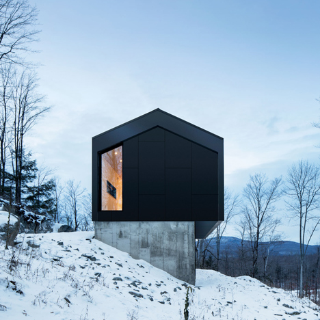 Quebec residence by Naturehumaine is&ltbr /&gt raised off a slope on a concrete podium