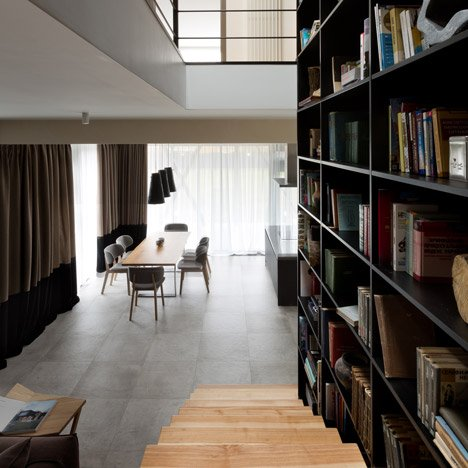 Ukraine house by Sergey Makno combines a staircase with a two-storey-high bookcase