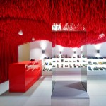 30,000 red shoelaces hang from the ceiling of Melbourne's Camper store