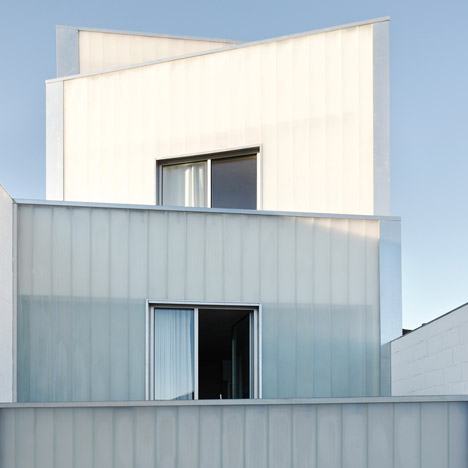 Rue Space's Casa #20 features a four-tiered facade of translucent glass