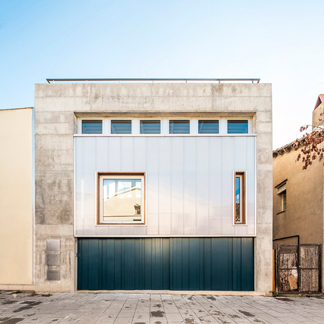SAU Taller de Arquitectura's Casa Migdia<br /> features sliding screens and a moveable wall