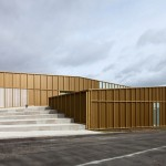 Ateliers O-S adds golden metal walls to cultural centre beside a French cemetery