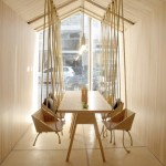 Fiii Fun House cafe by Íris Cantante features wooden swing seats