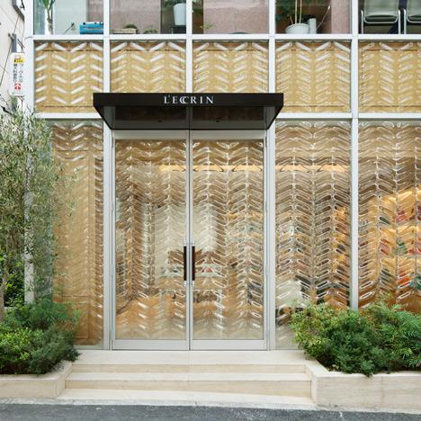 Chevron-patterned glass fronts Tokyo handbag store by Hiroshi Nakamura