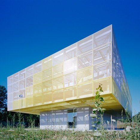 Yellow mesh box sits atop Ateliers O-S's truck-driving school building in France