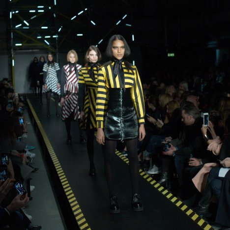 Travelator catwalk carries models around House of Holland fashion show