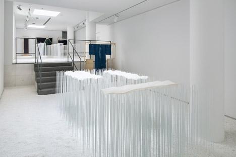 Yusuke Seki showcases fragile hemp textiles across banks of metal rods