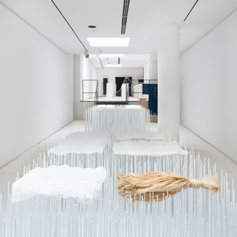 Yusuke Seki showcases fragile hemp textiles across banks of metal rods