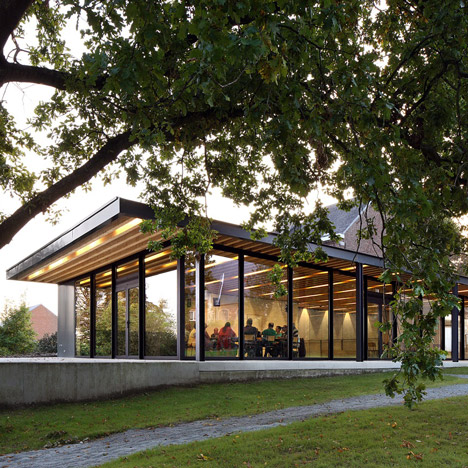Glazed pavilions form a community centre in the grounds of an old Flemish manse