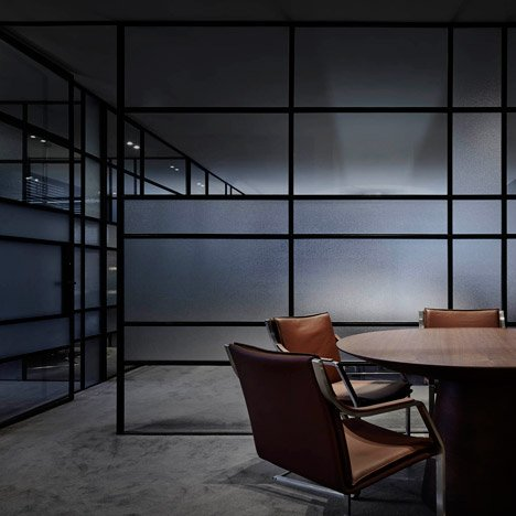 "B.E. Architecture's ""relaxed"" office for a mortgage broker uses soft lighting and frosted glass"