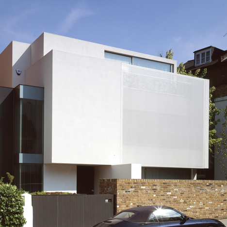 Stretched fabric hides the windows and<br /> balconies of an artist's Hampstead home