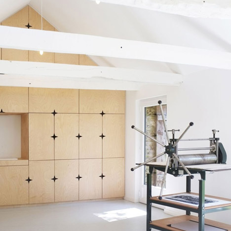 Old French barn converted into printmaker's studio by Modal Architecture