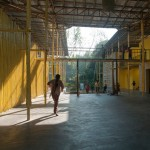 Bamboo-framed canopy shades Bangladesh community centre by Schilder Scholte