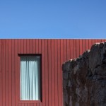 Pitágoras Arquitectos adds red timber wing to stone farmhouse in rural Portugal