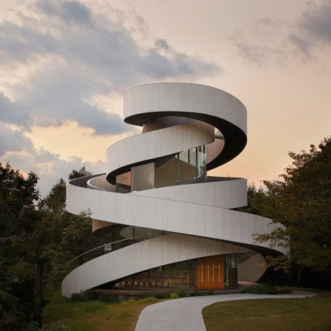 Intertwining staircases spiral around the glazed<br /> core of Hiroshi Nakamura's Ribbon Chapel