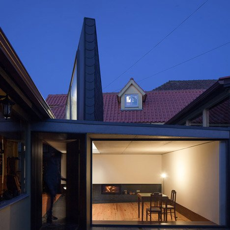 Nuno Melo Sousa uses a wedge-shaped lightwell to bring light into a courtyard living room