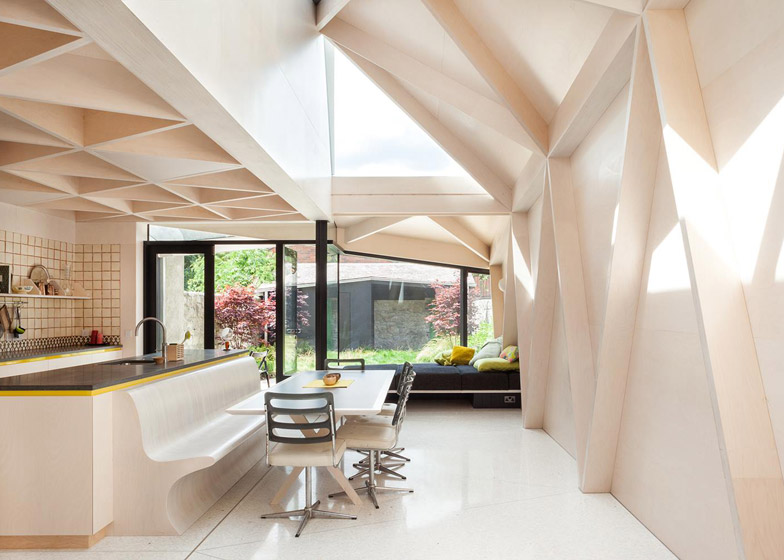 Plywood frames create a triangle pattern inside extension