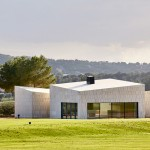 "Golf clubhouse designed by GRAS to resemble ""a rock in the middle of the course"""