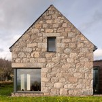 Gabled stone and glass Torispardon house reinterprets Scottish farm buildings