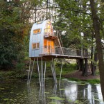 Treehouse Solling raised above an artificial lake on stilts