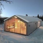 Mountain lodge by Reiulf Ramstad Architects has a V-shaped footprint that follows the terrain