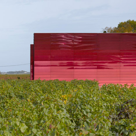 Bright red mirrors clad Jean Nouvel's addition to a French wine-making estate