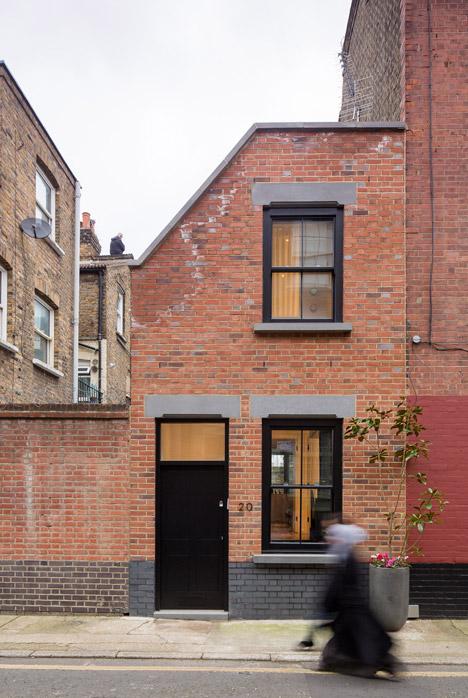 Old upholsterer's workshop in London transformed into a narrow brick home
