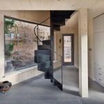 Stilted woodland cabin by ALT Architekti boasts a spiralling metal staircase