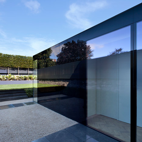 Black glass box forms a reflective extension to a Victorian townhouse in Dublin