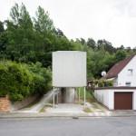 Micro house by Architekturbüro Scheder is raised off the ground on stilts