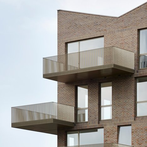 Edges apartments resembles a tower of offset brick blocks Metal piers for housing