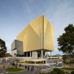 Woods Bagot adds elevated golden tower to Melbourne's Deakin University