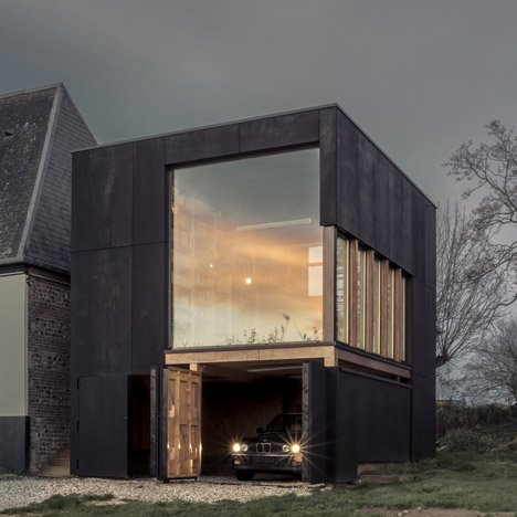 Blackened timber reading room extends a coastal home in northern France