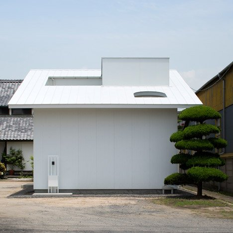 Japanese house extension by Container Design is arranged around a covered courtyard