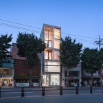 JMY Architects combines living and retail spaces on a narrow site in Busan