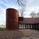 Chris Dyson Architects adds a rusty steel tower to a rural stone cottage